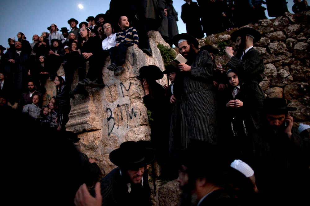 . Ultra-Orthodox Jews collect water to make matza during the Maim Shelanoo ceremony at a mountain spring, in Jerusalem Sunday March 24, 2013. The water is used to prepare the traditional unleavened bread for the high holiday of Passover which begins Monday. (AP Photo/Oded Balilty)