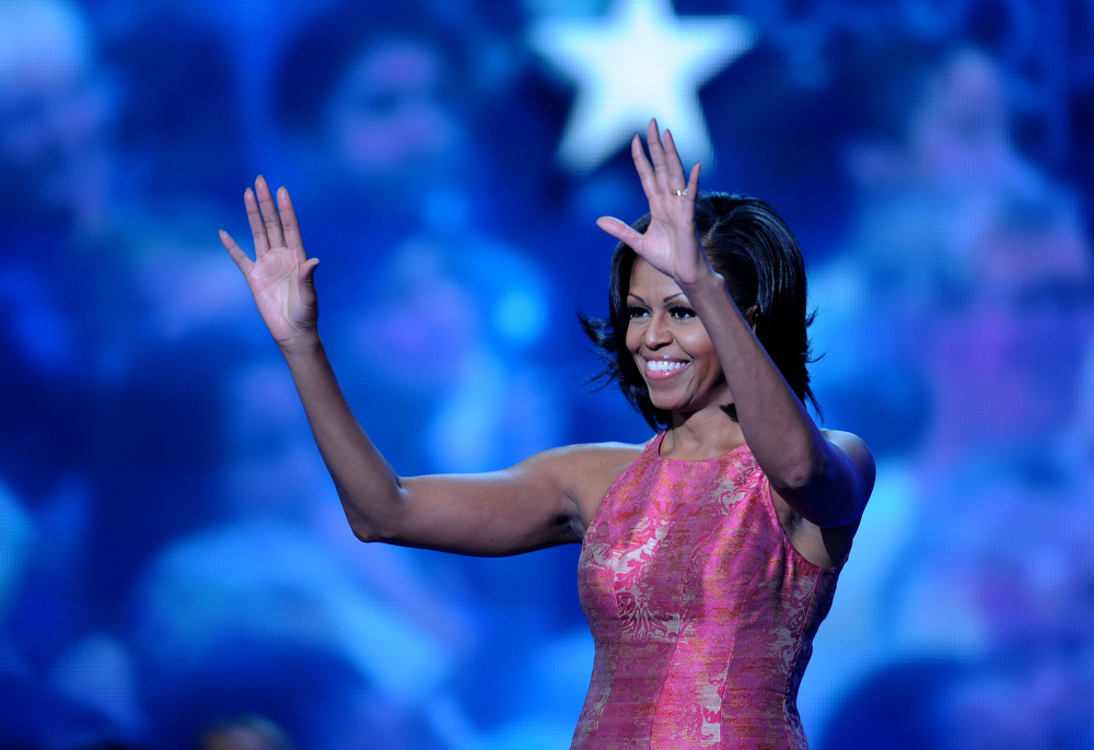 Description of . Michelle Obama waves good bye to the delegates after giving her highly anticipated speech for the evening at he Democratic National Convention tonight  September 4th, 2012 in Charlotte, North Carolina. Also featured  at tonight's convention held in the Time Warner Cable Arena was Julian Castro, San Antonio mayor and the democratic party's first latino keynote speaker. Helen H. Richardson, The Denver Post