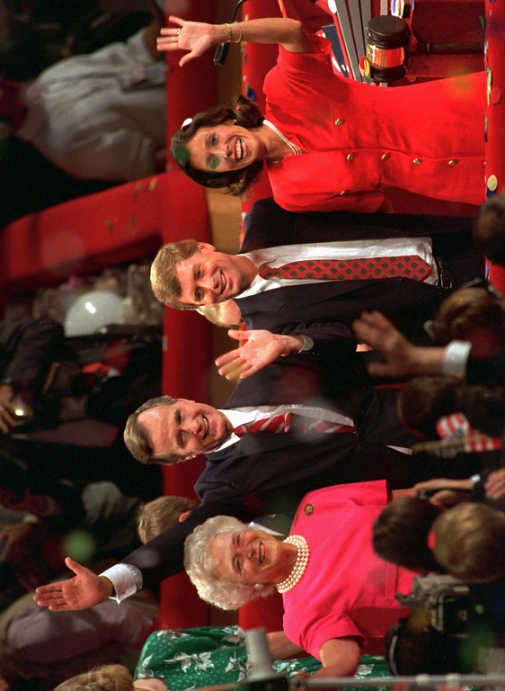 . Vice President George Bush and his wife Barbara, left, stand with Senator Dan Quayle, R-Ind., and his wife Marilyn, right, on the podium Thursday, Aug. 18, 1988 at the Republican National Convention in New Orleans. (AP Photo/Ron Edmonds)
