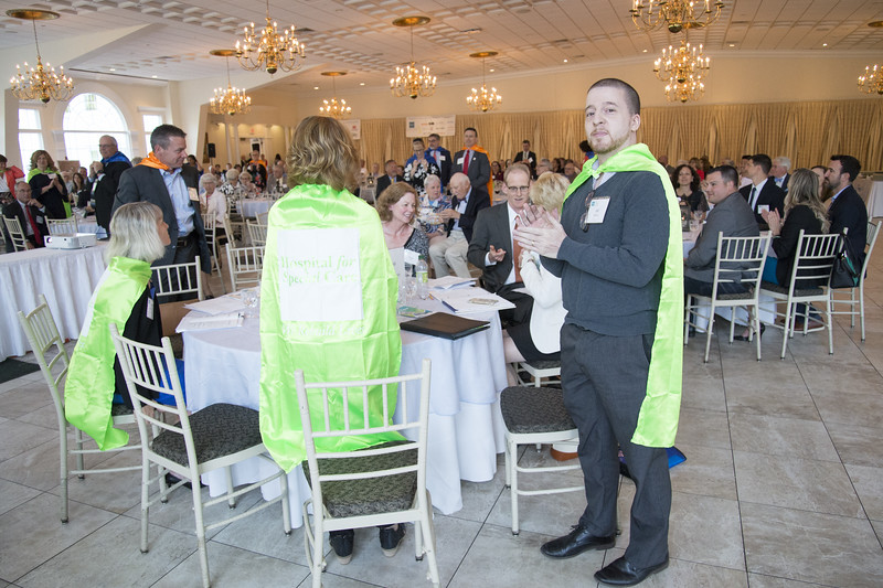 06/12/19  Wesley Bunnell | Staff  Ed LaRose, R, wears a cape as he stands during the Center of Special Care meeting on June 12, 2019 at the Aqua Turf in Southington.  LaRose spoke to attendees regarding his son Ellis' services he receives for autism from the hospital.