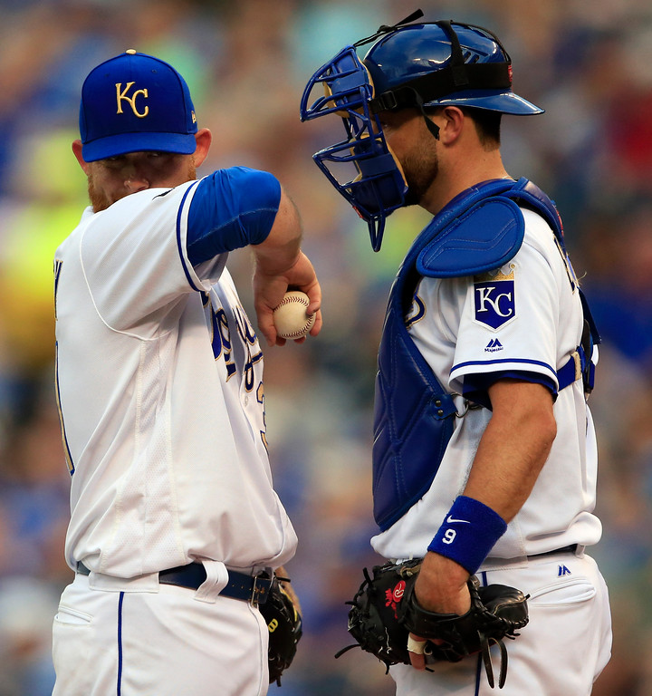 . Kansas City Royals starting pitcher Ian Kennedy, left, and catcher Drew Butera, right, talk after Kennedy gave up a home run during the first inning of a baseball game against the Cleveland Indians at Kauffman Stadium in Kansas City, Mo., Friday, Aug. 18, 2017. (AP Photo/Orlin Wagner)