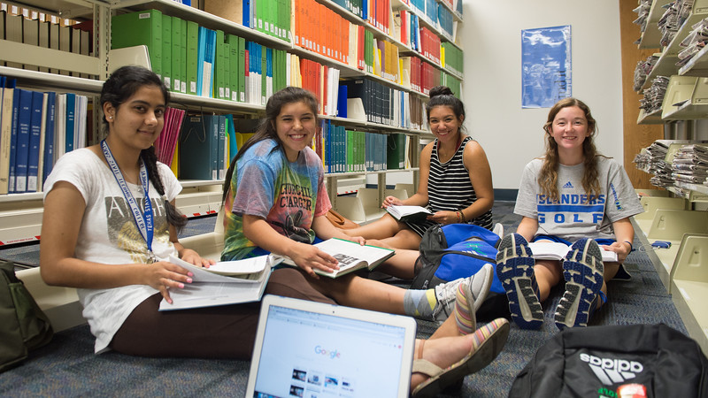 Prabhjot Kaur(left) Mikkie Flores, Bianca Arausa and Michelle Grilliette work together on their studies in the library.