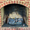 Close up of gas fireplace surrounded with brick.