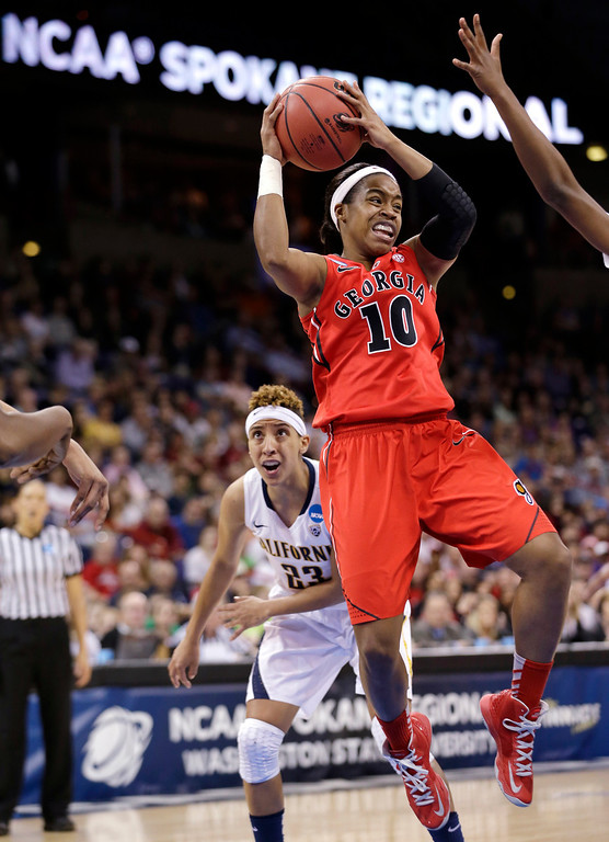. Georgia\'s Jasmine James (10) drives the lane in front of California\'s Layshia Clarendon during the first half in a regional final in the NCAA women\'s college basketball tournament, Monday, April 1, 2013, in Spokane, Wash. (AP Photo/Elaine Thompson)