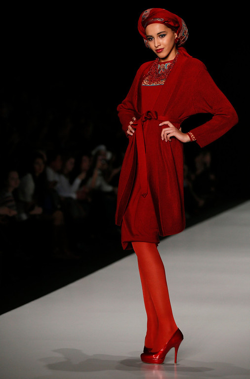 . A model presents a creation by Russian designer Slava Zaitsev at the Fashion Week in Moscow, Friday, Oct. 25, 2013. (AP Photo/Alexander Zemlianichenko)