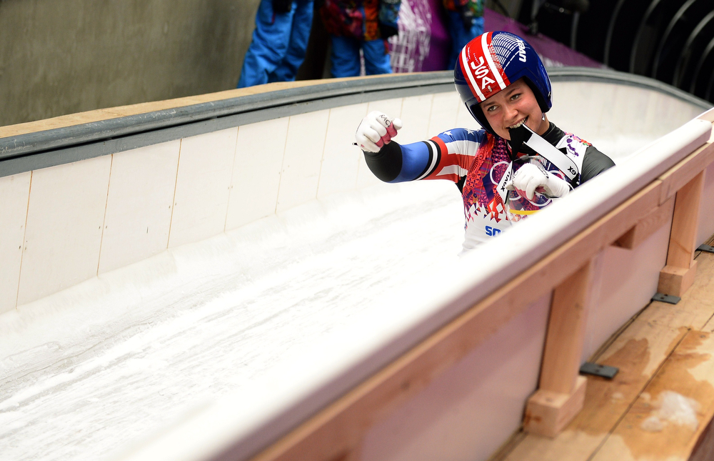 . US Erin Hamlin gestures after her run 3 in the Women\'s Luge Singles event of the Sochi Winter Olympics on February 11, 2014 at the Sanki Sliding Center. (LIONEL BONAVENTURE/AFP/Getty Images)