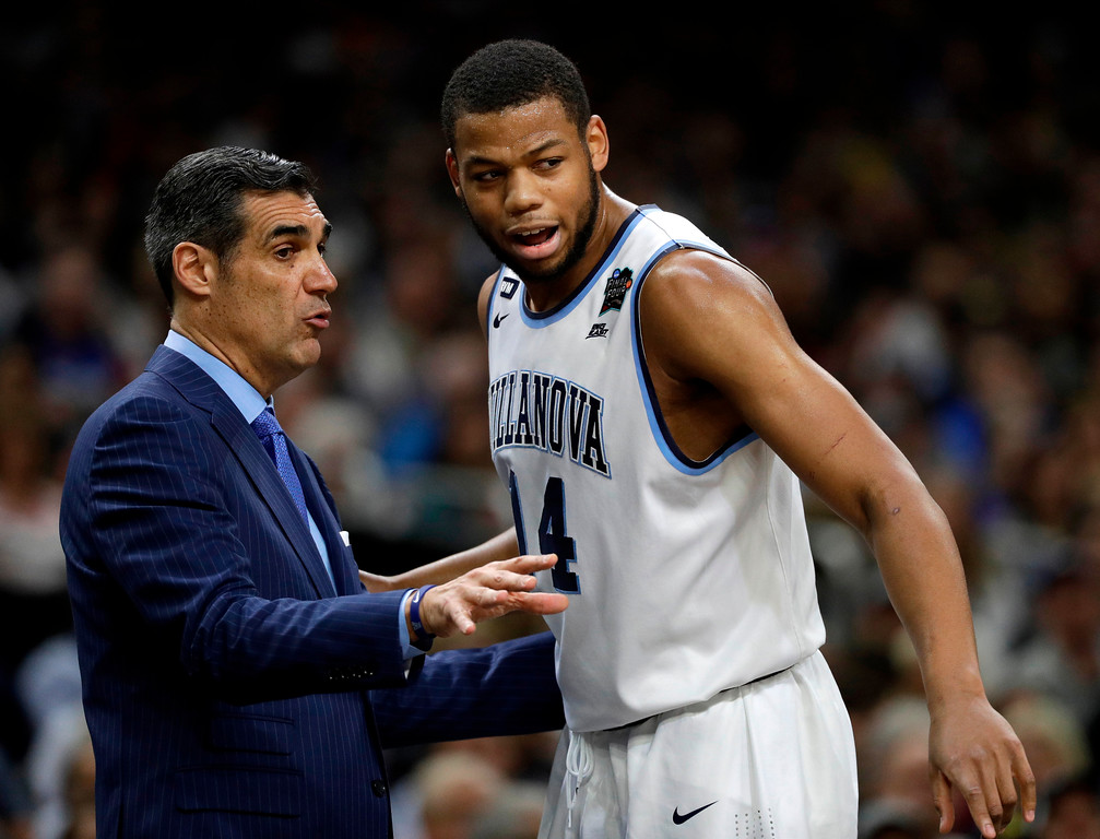 . Villanova head coach Jay Wright, left, talks with forward Omari Spellman during the first half against Michigan in the championship game of the Final Four NCAA college basketball tournament, Monday, April 2, 2018, in San Antonio. (AP Photo/David J. Phillip)