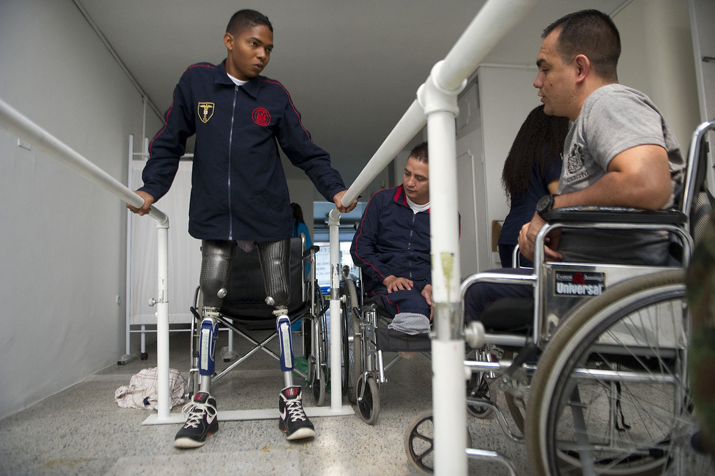 . Colombian soldier Mario Ballesteros (L), victim of a land mine explosion 15 months ago, tries his new prosthesis at the Heroes de Paramillo hospital  in Medellin, Antioquia department, Colombia on September 11, 2013. The Heroes de Paramillo hospital is the first in Latin America for soldiers victims of land mine explosions According to the government and human rights organizations, Colombia is one of the countries with the largest number of land mine victims.  RAUL ARBOLEDA/AFP/Getty Images