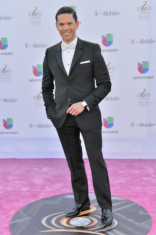 ". Rodner Figueroa arrives at the 25th Anniversary of Univision\'s \""Premio Lo Nuestro A La Musica Latina\"" on February 21, 2013 in Miami, Florida.  (Photo by Gustavo Caballero/Getty Images for Univision)"