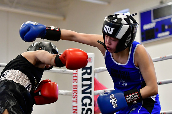 3/16/2019 Mike Orazzi | Staff West Points Amira Mohamed (red) and Penn States Eliza Kuehner (blue) in a 119 match during the National Collegiate Boxing Association National Qualifier held at the Bristol Boys & Girls Club in Bristol, Conn. on Saturday.
