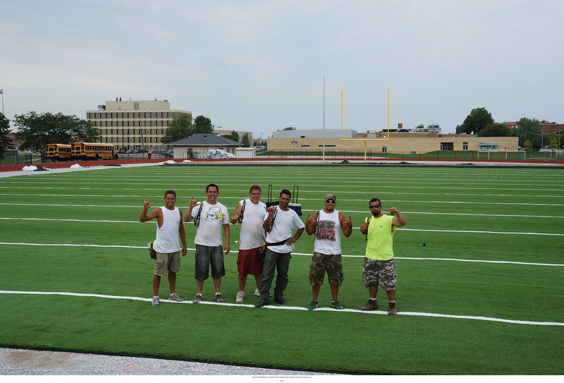 The Sports Construction Group work crew getting into the Longhorn spirit.