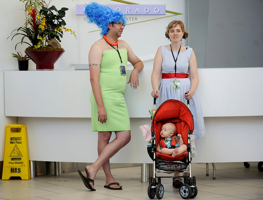 . John Ashley dressed as Marge Simpson waits with his wife, Maria, and daughter, Louella, for an escort inside during Denver Comic Con at the Colorado Convention Center on June 2, 2013 in Denver, Colorado. (Photo by Seth McConnell/The Denver Post)