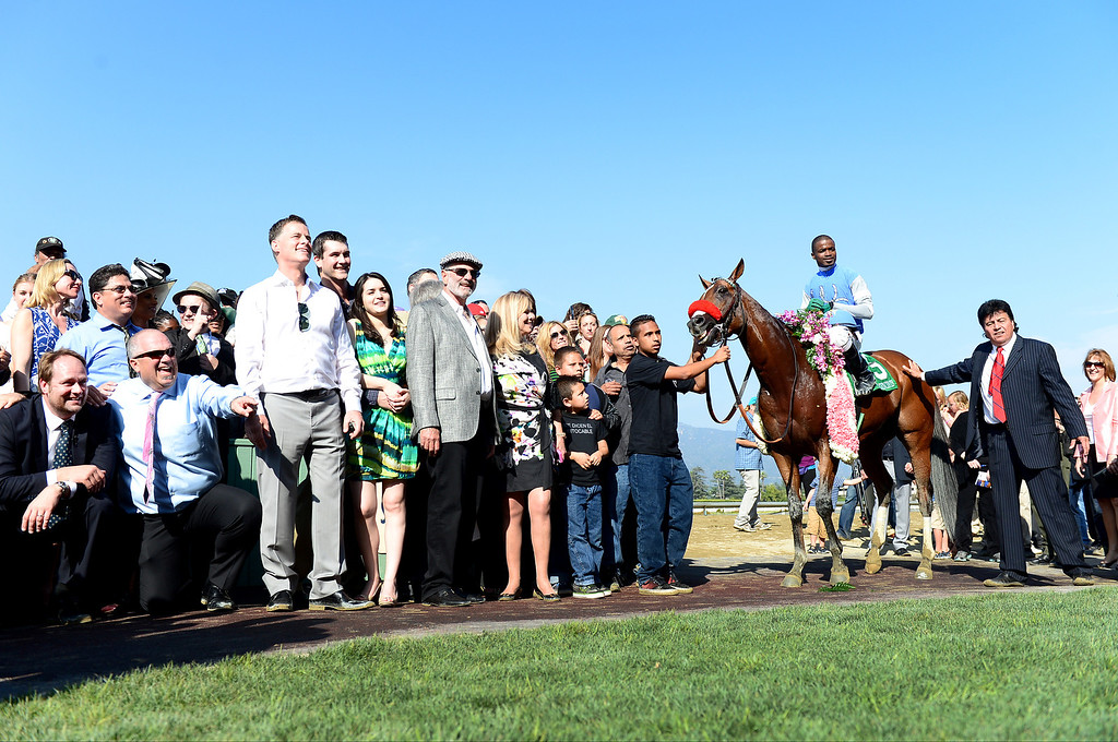 . Jockey Kevin Krigger celebrates Goldencents Santa Anita Derby win Saturday, April 6, 2013 at Santa Anita Park in Arcadia. Goldencents will now race in the Kentucky Derby. (SGVN/Staff Photo by Sarah Reingewirtz)
