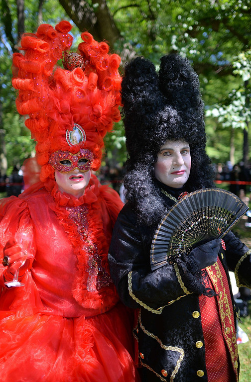 . A couple wears phantasy costumes with the motto «Rococo goes crazy» during the Wave-Gothic-meeting in Leipzig-Markkleeberg, eastern Germany on June 6, 2014. Organizers expect about 20,000 visitors to one of the biggest gothic festivals worldwide, running from June 6 - 9, 2014. AFP PHOTO / DPA/ HENDRIK SCHMIDT /AFP/Getty Images