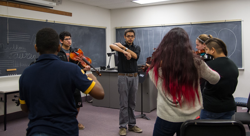 Instructors at the TAMU-CC's Coastal Bend String Camp, teach students proper technique when playing the Viola Tuesday July 28, 2015.