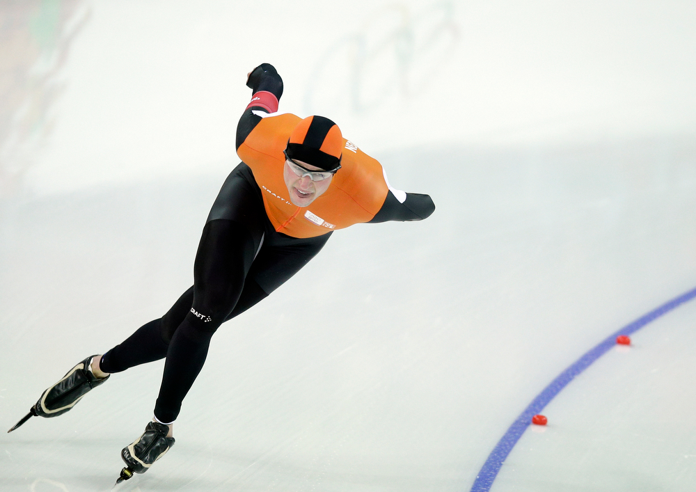 . Sven Kramer of the Netherlands skates on his way to a new Olympic record in the men\'s 5,000-meter speed skating race at the Adler Arena Skating Center during the 2014 Winter Olympics in Sochi, Russia, Saturday, Feb. 8, 2014. Netherland\'s Sven Kramer, one of the most decorated speed skaters in history, won the gold in Vancouver. (AP Photo/Pavel Golovkin)