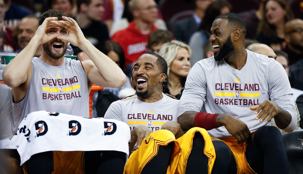 . Cleveland Cavaliers\' Kevin Love, left, J.R. Smith, center, and LeBron James share a laugh on the bench during the second half of an NBA basketball game against the Dallas Mavericks on Friday, Nov. 25, 2016, in Cleveland. The Cavaliers won 128-90. (AP Photo/Ron Schwane)