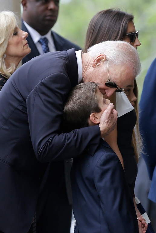 . Vice President Joe Biden embraces his grandson Hunter before funeral services for Hunter\'s father, former Delaware Attorney General Beau Biden, Saturday, June 6, 2015, at  St. Anthony of Padua Roman Catholic Church in Wilmington, Del. Biden, the eldest son of the vice president, died of brain cancer May 30 at age 46. (AP Photo/Patrick Semansky)