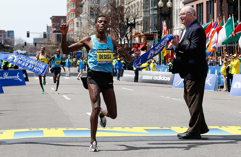 . Lelisa Desisa Benti of Ethiopia crosses the finish line to win the men\'s division of the 117th Boston Marathon on April 15, 2013 in Boston, Massachusetts.  (Photo by Jim Rogash/Getty Images)