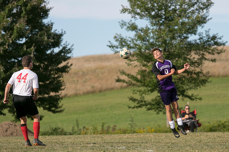 Trivium High School boys soccer played South Lancaster Academy on Thursday afternoon in Lancaster. Going up for a header is SLA's Kevin Andreau. SENTINEL & ENTERPRISE/JOHN LOVE