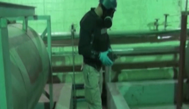 . An image grab taken from Syrian television shows an inspector from the Organisation for the Prohibition of Chemical Weapons (OPCW) at work at an undisclosed location in Syria on October 8, 2013. 2013 Nobel Peace Prize is to go to Organisation for the Prohibition of Chemical Weapons (OPCW), Norwegian television NRK reported on October 11, 2013 one hour before the official announcement.  AFP/Getty Images