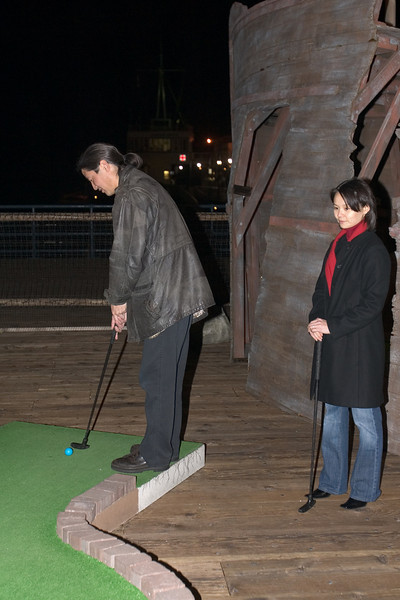 Several of us play a round of miniature golf