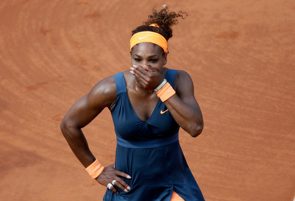 . USA\'s Serena Williams celebrates as she wins the 2013 French tennis Open final against Russia\'s Maria Sharapova at the Roland Garros stadium in Paris on June 8, 2013.   AFP PHOTO / KENZO TRIBOUILLARD/AFP/Getty Images