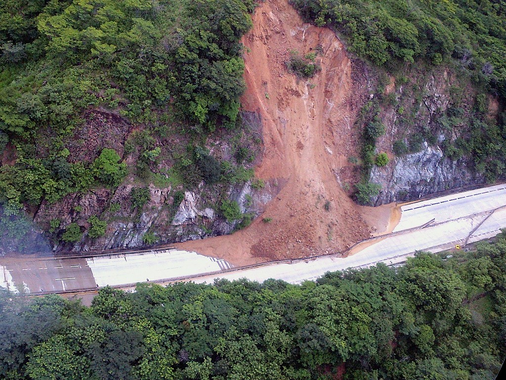 . This handout photo taken and released on September 18, 2013 by Mexico\'s Interior Ministry press office shows an aerial view of a landslide along a highway going to Acapulco, in the Mexican state of Guerrero, as heavy rains hit the country. AFP PHOTO/ Interior MINISTRY -/AFP/Getty Images