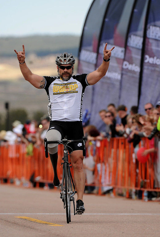 . SOCOM Christopher Self, holds up his hands in jubilation as he crosses the finish line and wins the Men\'s 30K Bicycle Disability race.  He ended up winning the race with a time of 52:35.   The fourth annual Warrior Games cycling event took started and finished at Falcon Stadium on the grounds of the Air Force Academy in Colorado Springs, CO on May 12, 2013.  HRH Prince Harry was on hand to start the race as well as to hand out medals at the finish line.   A total of 260 wounded, ill and injured service members and veterans came to compete in the week long games.  Members of the Army, Marine Corps, Navy/Coast Guard/Air Force. Special Operations and the British Armed Forces all took part in the competition.  Other events included in the Warrior Games are shooting, sitting volleyball, track & field and wheelchair basketball.  (Photo by Helen H. Richardson/The Denver Post)