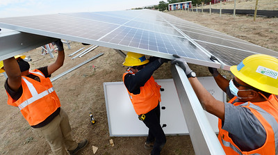 Photos:  Solar Installation by GRID and Boulder Housing Partners