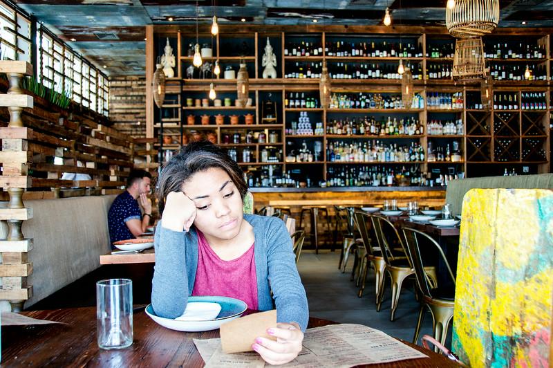 Issa looking at the menu at Khong River House