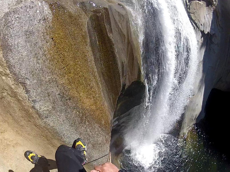 Repelling a waterfall in Jump Canyon in the Sierra Nevada Foothills of California.