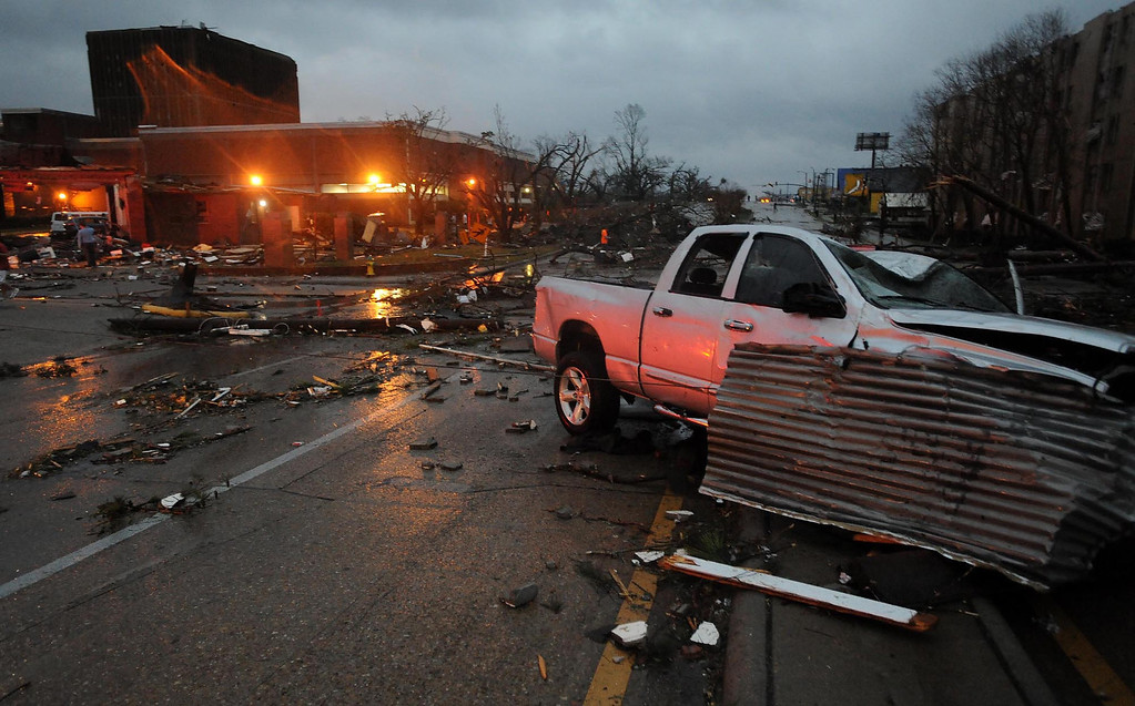 . A heavily damaged vehicle sits near the front of the University of Southern Mississippi on Hardy Street in Hattiesburg Miss., Feb 10, 2013 after a tornado passed through the city Sunday afternoon. (AP Photo/Hattiesburg American, Ryan Moore)