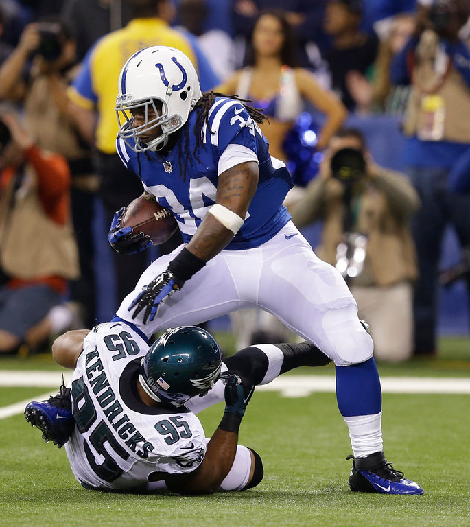 . Indianapolis Colts running back Trent Richardson (34) is tackled by Philadelphia Eagles inside linebacker Mychal Kendricks during the first half of an NFL football game Monday, Sept. 15, 2014, in Indianapolis. (AP Photo/Michael Conroy)