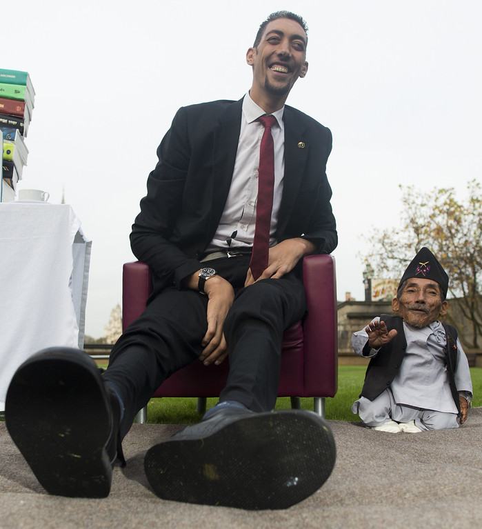 . Chandra Bahadur Dangi, from Nepal, (R) the shortest adult to have ever been verified by Guinness World Records, is pictured with the world\'s tallest man Sultan Kosen from Turkey, during a photocall in London on November 13, 2014, to mark Guinness World Records Day. Chandra Dangi, measures a tiny 21.5in (0.54m)  the same height as six stacked cans of beans. Sultan Kosen measures 8 ft 3in (2.51m).  AFP PHOTO / ANDREW  COWIE/AFP/Getty Images