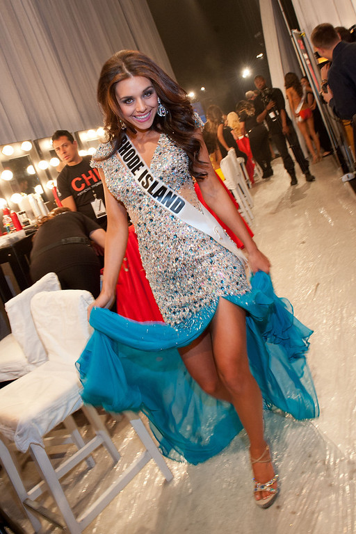 . This photo provided by the Miss Universe Organization,  Miss Rhode Island USA 2013, Brittany Stenovitch gets ready to go on stage prior to the 2013 Miss USA Competition Preliminary Show  in Las Vegas  on Wednesday June 12, 2013.  She will compete for the title of Miss USA 2013 and the coveted Miss USA Diamond Nexus Crown on June 16, 2013.  (AP Photo/Miss Universe Organization, Valerie Macon)
