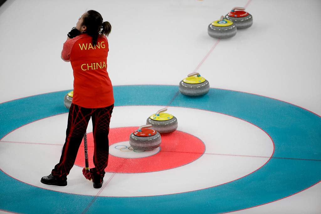 . China\'s Wang Rui looks up during a mixed doubles curling match against Norway\'s Kristin Skaslien and Magnus Nedregotten at the 2018 Winter Olympics in Gangneung, South Korea, Sunday, Feb. 11, 2018. (AP Photo/Natacha Pisarenko)