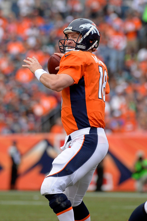 . Denver Broncos quarterback Peyton Manning (18) throws during the third quarter.  (Photo by Joe Amon/The Denver Post)