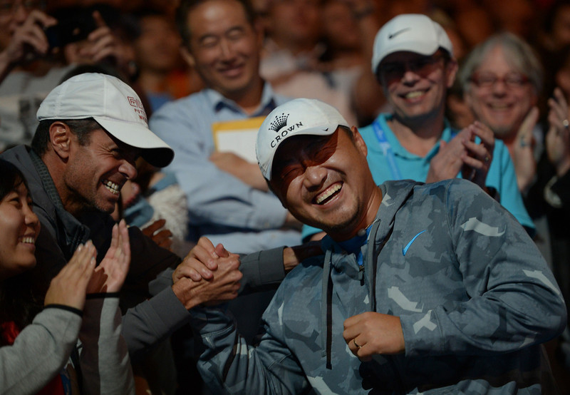 . Jiang Shan (R) the husband of China\'s Li Na celebrates with Na\'s coach Carlos Rodriguez (L) after her victory in the women\'s singles final match against Slovakia\'s Dominika Cibulkova on day thirteen of the 2014 Australian Open tennis tournament in Melbourne on January 25, 2014. (GREG WOOD/AFP/Getty Images)