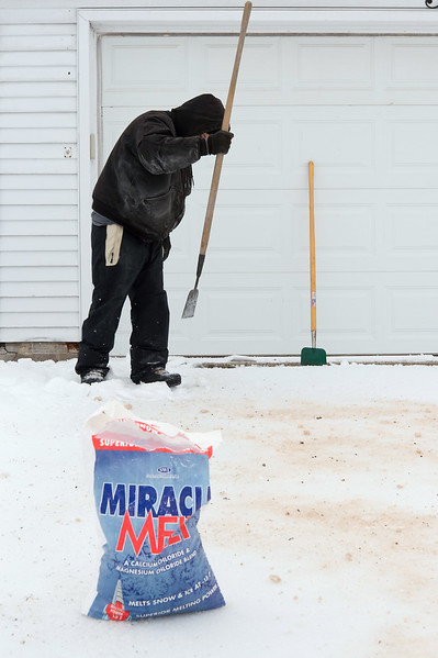 01/21/19  Wesley Bunnell | Staff  Raphael Reyes works on breaking up ice from a customers driveway in New Britain on a frigid Monday afternoon.