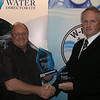 3  NSW Operator of the Year - Les Potter, Coffs Harbour Council (L) with Kent Boyd Deputy Chair of NSW Water Directorate