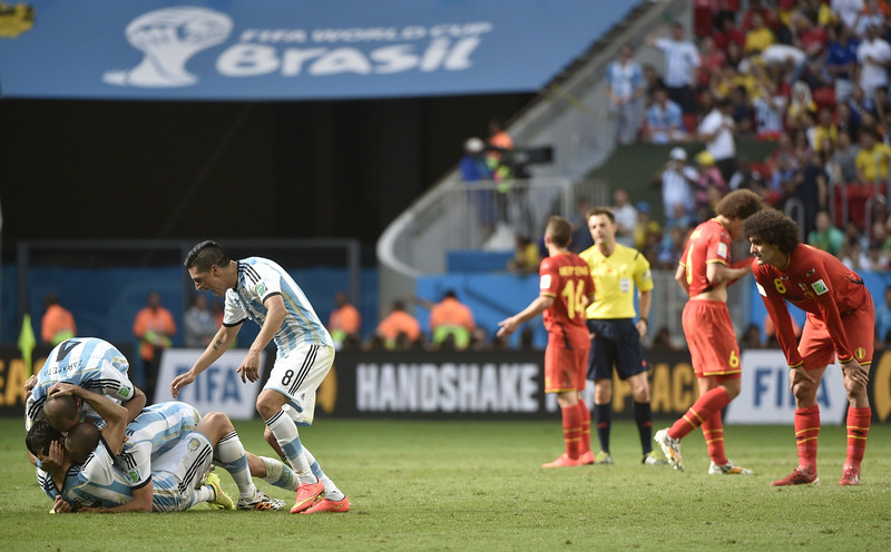 . Argentina\'s players (L) celebrate after winning a quarter-final football match between Argentina and Belgium at the Mane Garrincha National Stadium in Brasilia during the 2014 FIFA World Cup on July 5, 2014. (MARTIN BUREAU/AFP/Getty Images)
