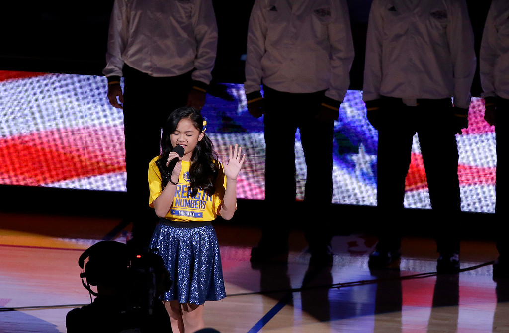 . Nayah Damasen performs the national anthem before Game 1 of basketball\'s NBA Finals between the Golden State Warriors and the Cleveland Cavaliers in Oakland, Calif., Thursday, June 4, 2015. (AP Photo/Eric Risberg)