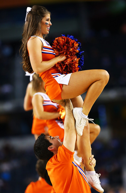 . ARLINGTON, TX - MARCH 29:  Florida Gators cheerleaders perform in the second half against the Florida Gulf Coast Eagles during the South Regional Semifinal round of the 2013 NCAA Men\'s Basketball Tournament at Dallas Cowboys Stadium on March 29, 2013 in Arlington, Texas.  (Photo by Tom Pennington/Getty Images)