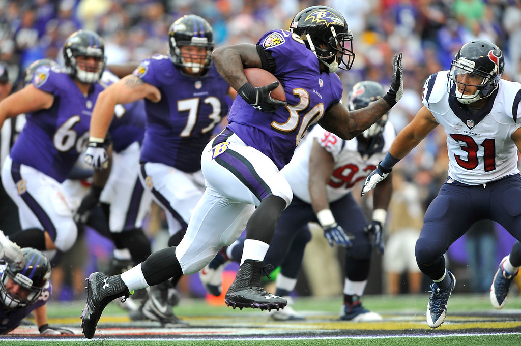 . Running back Bernard Pierce #30 of the Baltimore Ravens runs the ball against the Houston Texans at M&T Bank Stadium on September 22, 2013 in Baltimore, Maryland. The Ravens defeated the Texans 30-9. (Photo by Larry French/Getty Images)