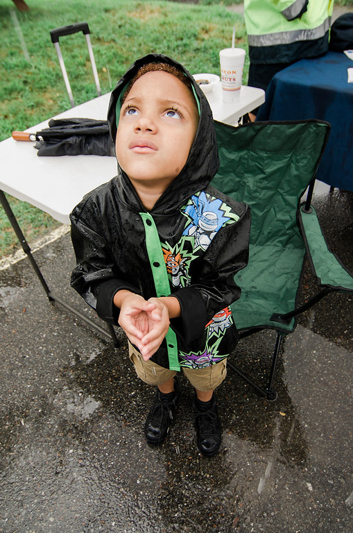 . Noah Rodriguez, 5, catches rain drops during the Spanish American Center\'s 50th anniversary block party on Saturday, August 5, 2017. SENTINEL & ENTERPRISE / Ashley Green