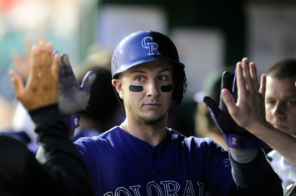 . WASHINGTON, DC - JUNE 30:  Troy Tulowitzki #2 of the Colorado Rockies celebrates with teammates after scoring in the sixth inning against the Washington Nationals at Nationals Park on June 30, 2014 in Washington, DC.  (Photo by Greg Fiume/Getty Images)