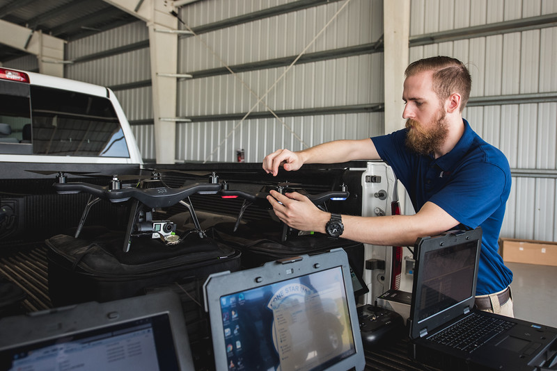 Software Engineer Hunter Morgan begins uploading flight plans, prior to the Lone Star UAS flight. Tuesday April 19, 2016.