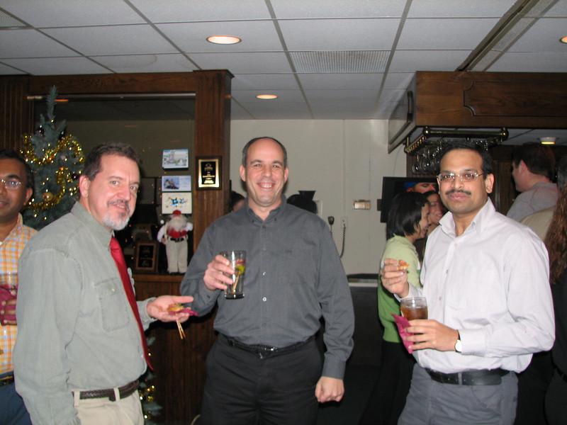 Mike Lyczak, Steve Gotkin and Manoj Darak, having a drink.