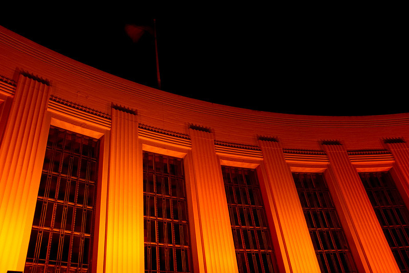 Building lit in orange on Treasure Island. The orange was in support of the San Francisco Giants playing in the World Series.
